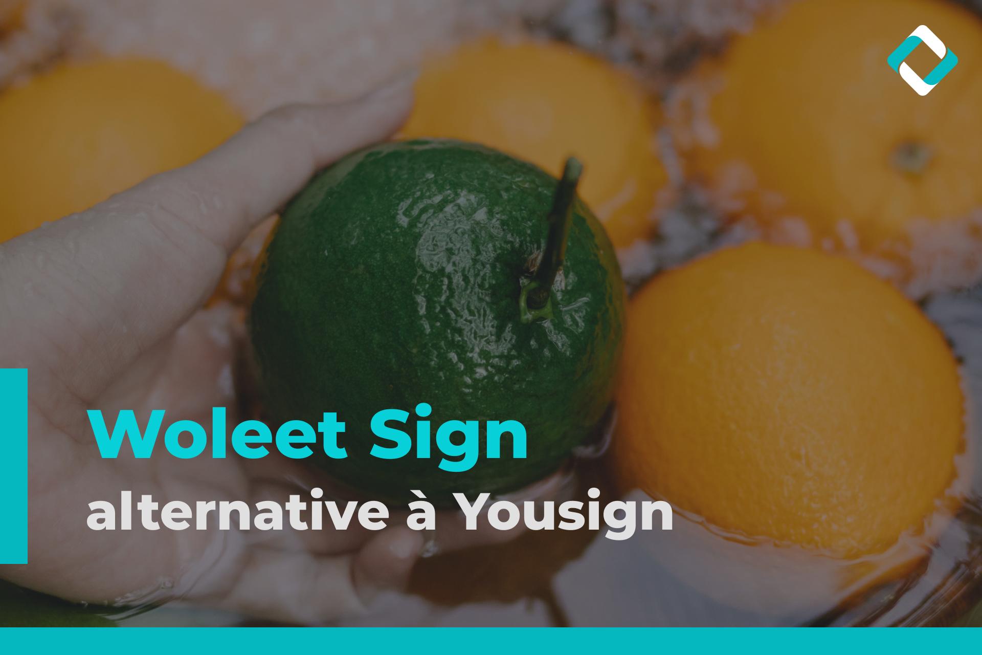 Woleet Sign alternative à Yousign - Une main prend un fruit vert parmi plusieurs fruits oranges